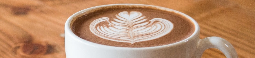 Latte inside a white coffee cup