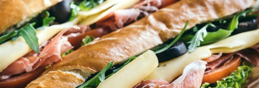 Large sandwiches with healthy ingredients inside.