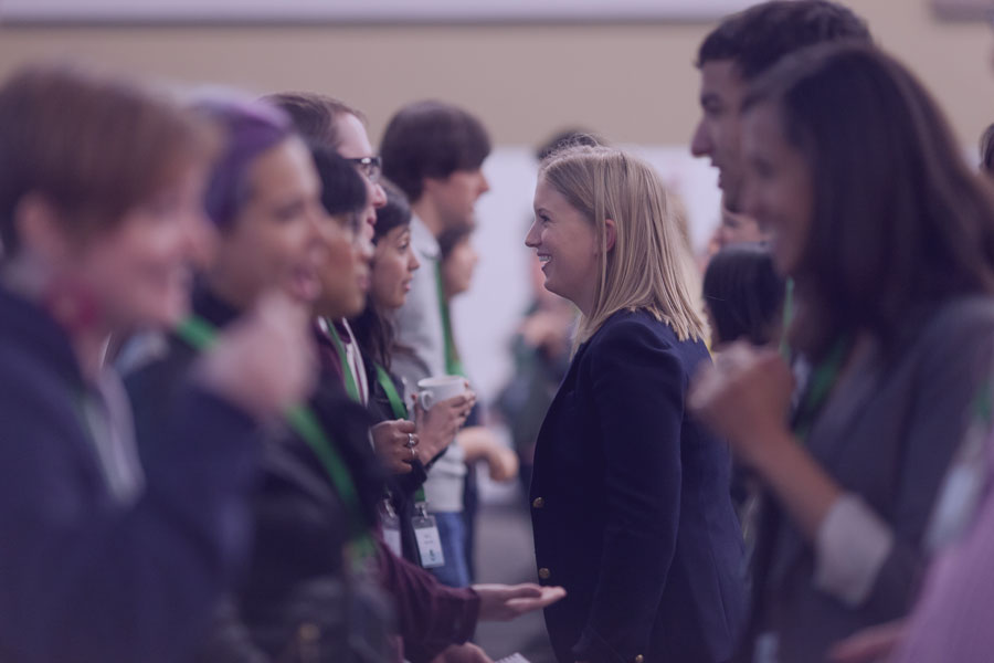 People chatting at the Beyond the Code Conference