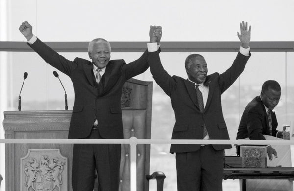 Mr. Mandela at the Inauguration of his successor Thabo Mbeki