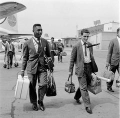 Pele In a Suit and Tie Traveling with Santos