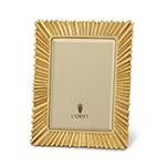 A gold, rectangular picture frame with radiant sunburst design.