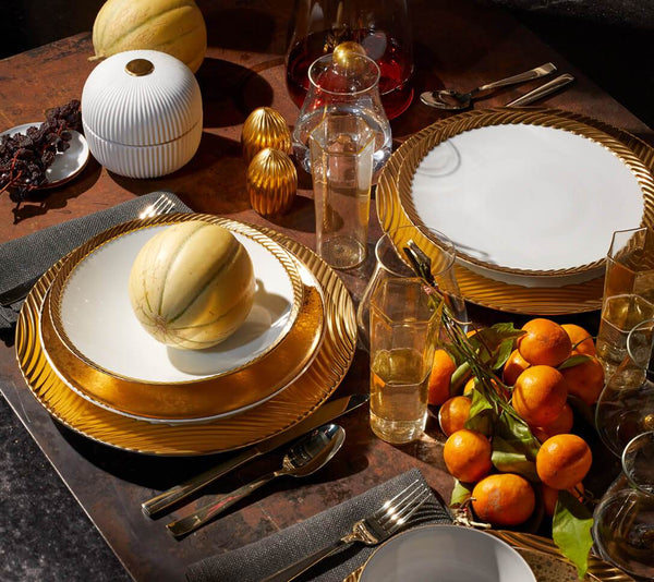 Tabletop set with gold corde and gold alchimie dinnerware patterns, glassware and a porcelain fluted plate box.