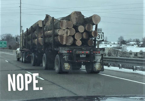 Final Destination. Unsecured truck hauling woods. Requires safety check