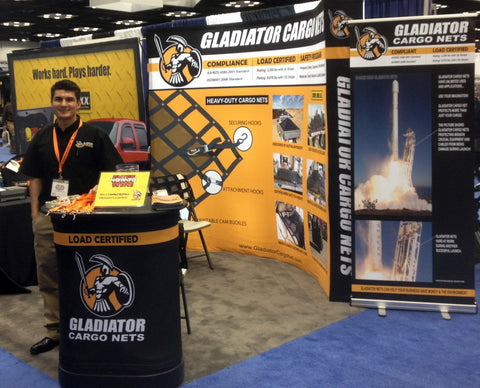 NTEA Work Truck Show- Gladiator Cargo Net Debut. Posters and man at booth
