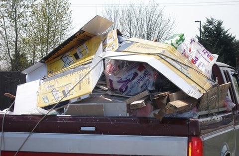 Unsecured load in the back of truck on roadway. Unsafe! Gladiator Cargo Nets solutions