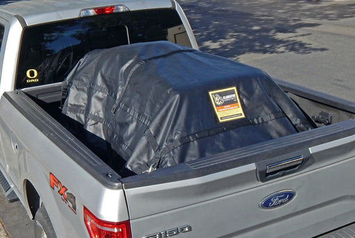 Waterproof cargo net used in short truck bed. Superior quality and durable design protecting loads from the elements.