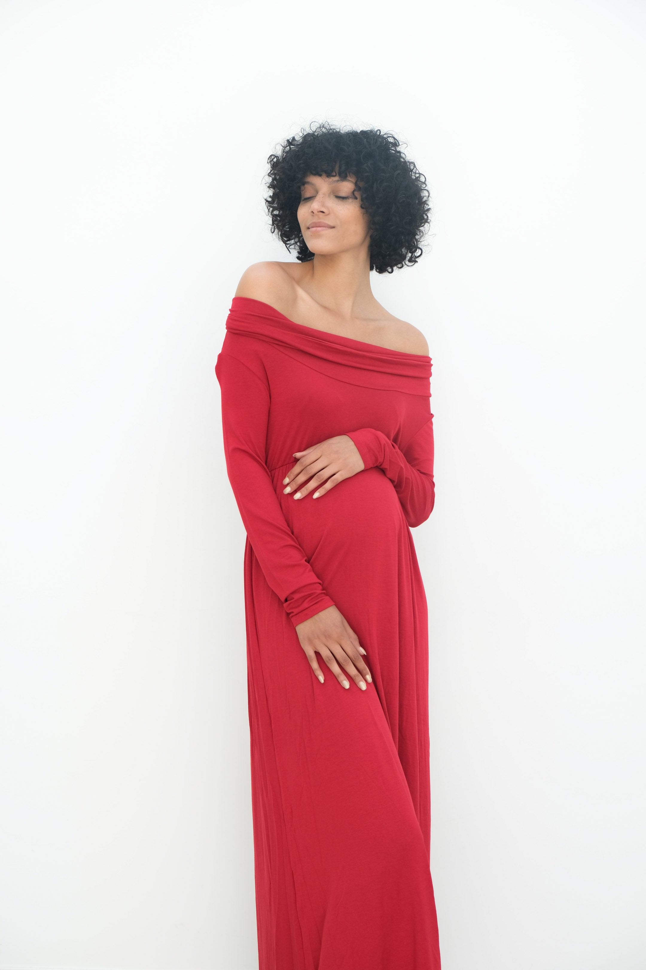 a lady wearing a bright red maternity gown called delaney