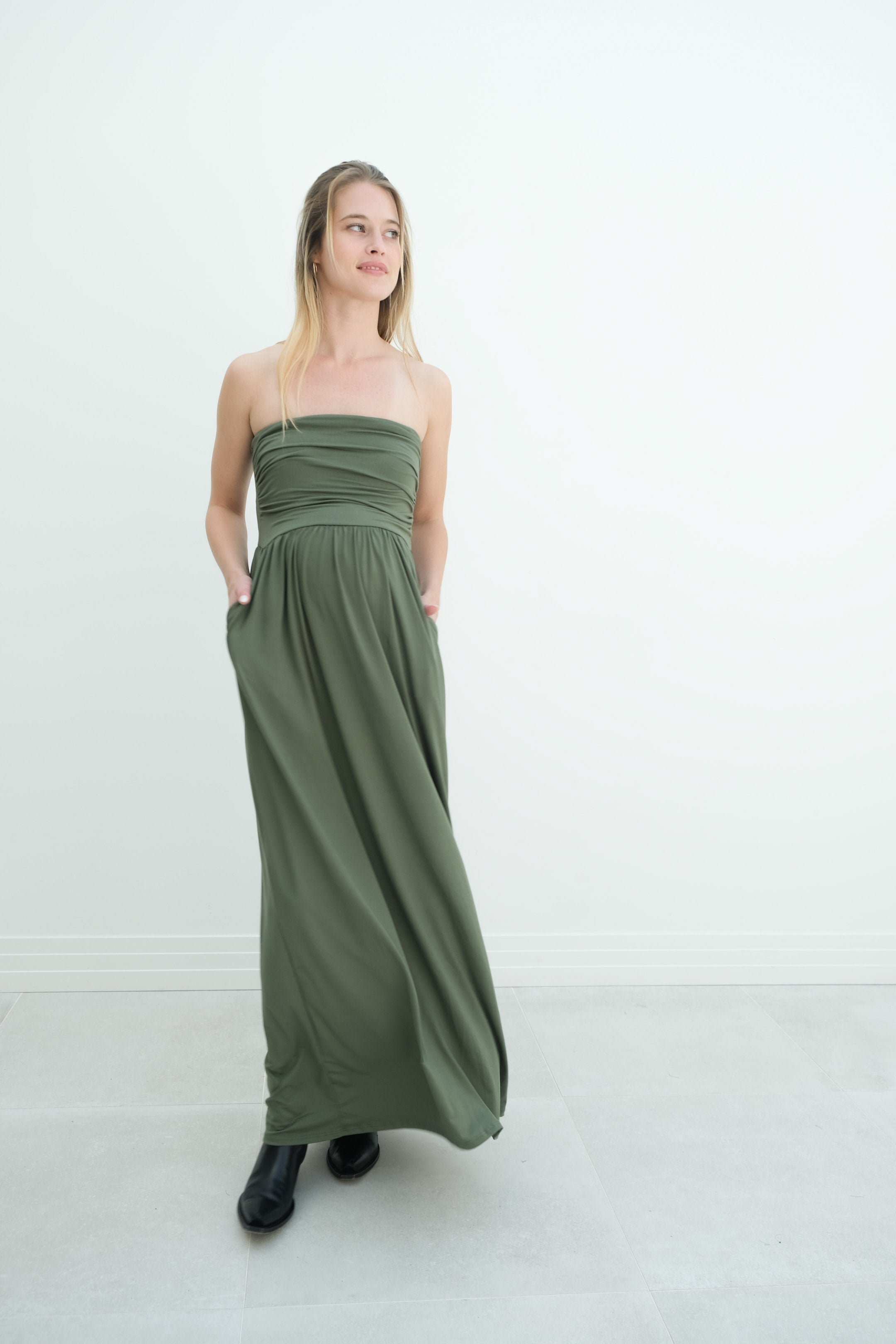 a woman in a green strapless pregnancy dress