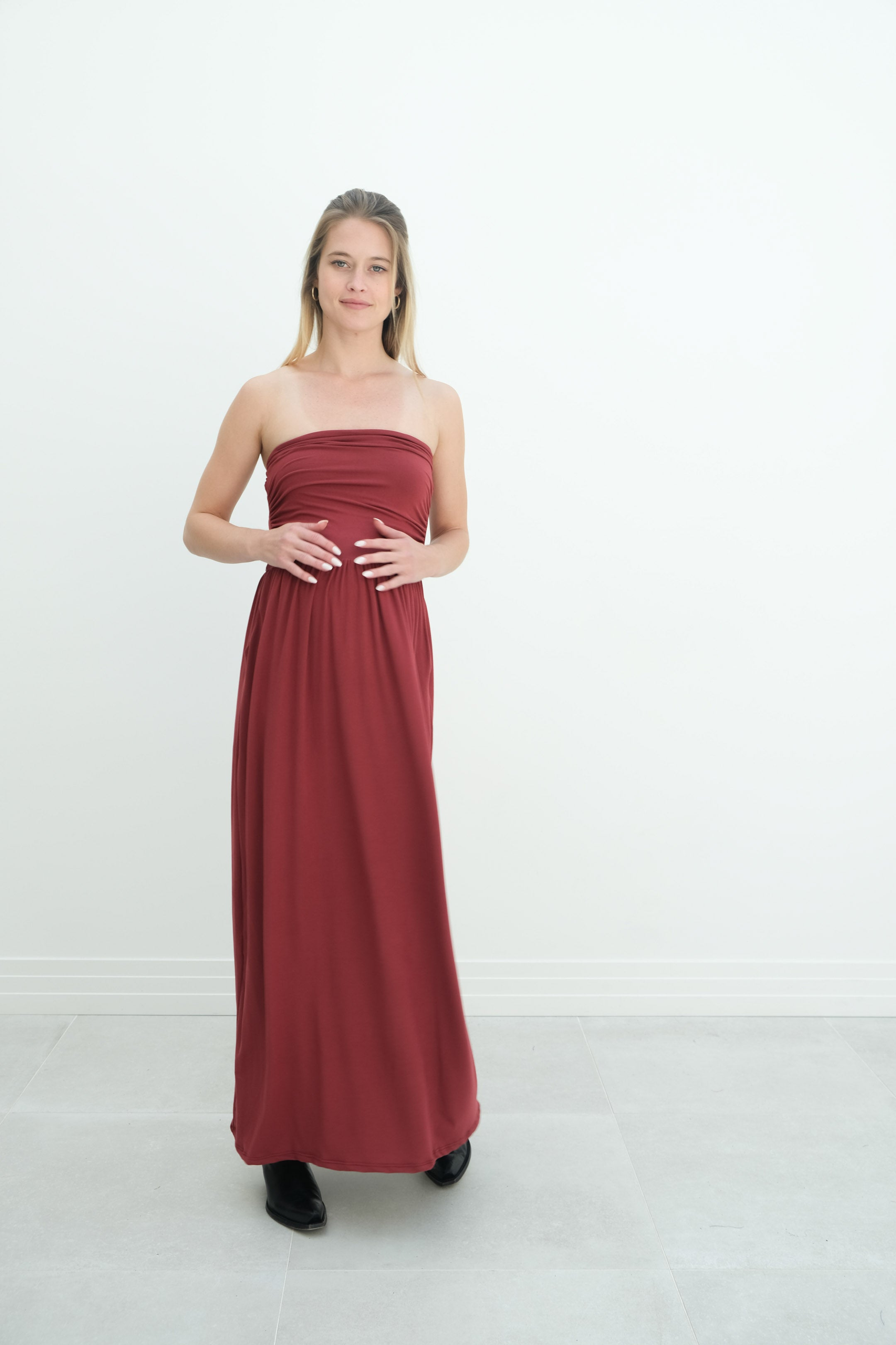 a lady wearing sasha bright red pregnancy gown