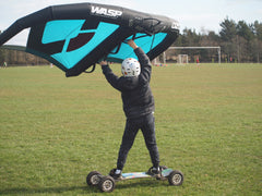 kids wing foiling on Ozone Wasp V1