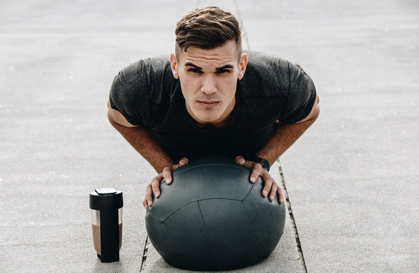 medicine ball pushup with protein shake