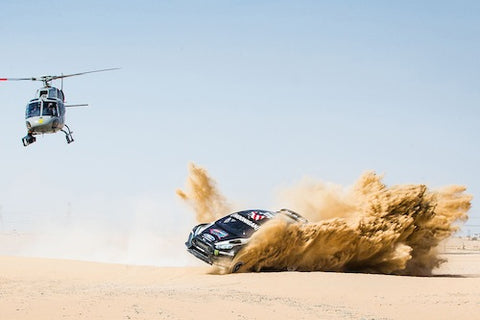 car and helicopter in the dessert