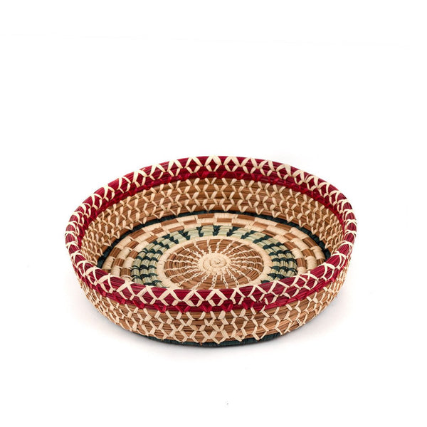 Round pine needle basket with dyed and undyed raffia