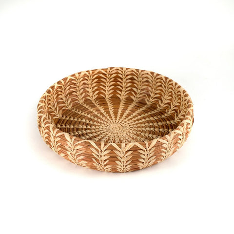 Round pine needle basket with raffia