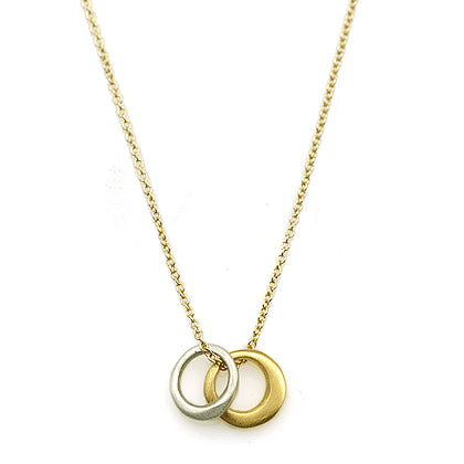 Philippa Roberts necklace with small silver and gold vermeil rings