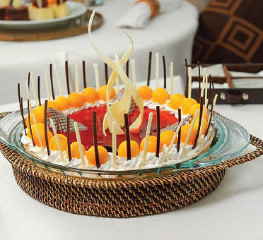 Glass baking dish with woven rattan holder