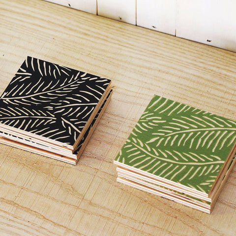 Colorful painted wood coasters with frond design, set of 2