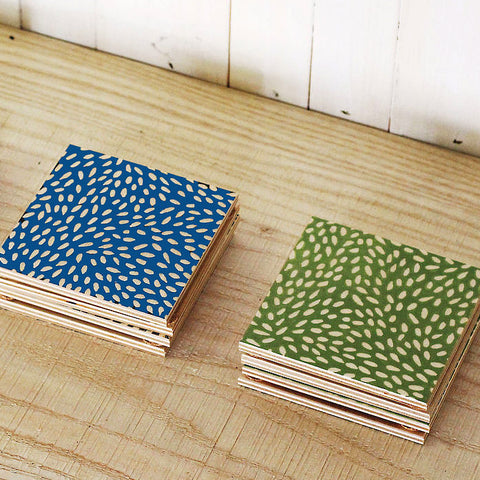 Colorful painted wood coasters with seed design, set of 2