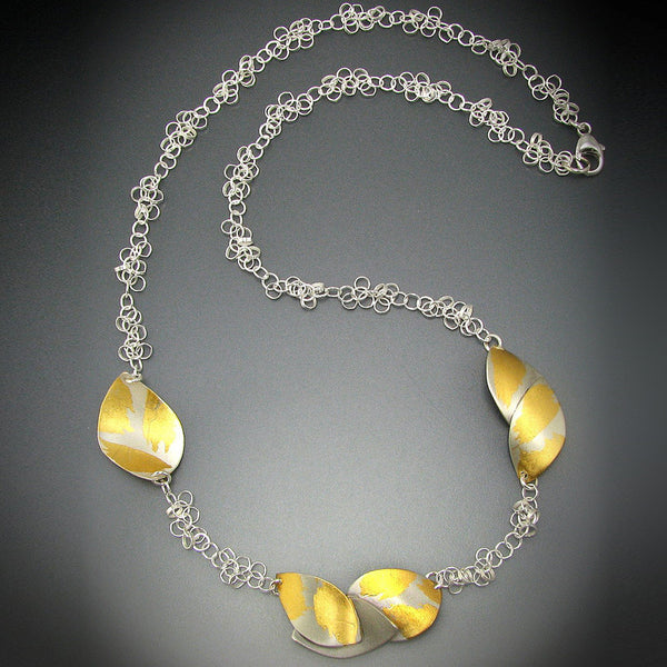Judith Neugebauer silver and gold leaf curved leaves necklace