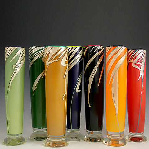 Glass bud vases with silver blades of grass