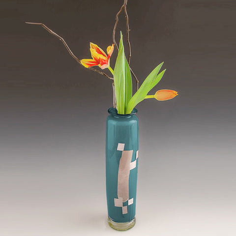Tall glass vase with abstract silver decoration