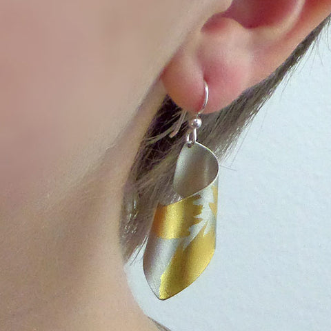 Judith Neugebauer silver and gold leaf short curls earrings