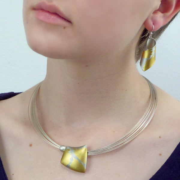 Judith Neugebauer silver and gold leaf pillow necklace with silver bead