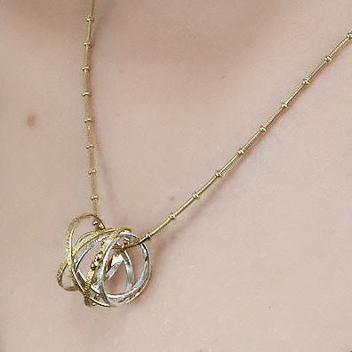 Kathleen Maley silver and gold vermeil double Mobius charm pendant