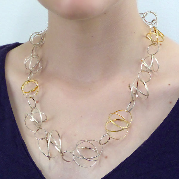 Kathleen Maley silver and gold vermeil graduated Mobius charms necklace
