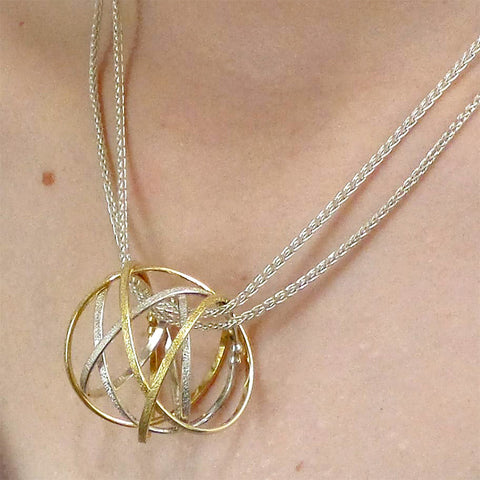Kathleen Maley silver and gold vermeil large Mobius charm pendant