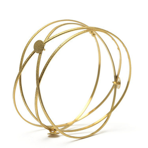 Kathleen Maley gold vermeil crossing textured bands orbit bracelet