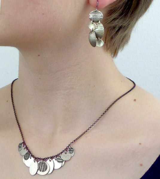 Martha Sullivan assorted textured oval silver discs necklace