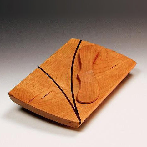 Small cherry wood board with spreader