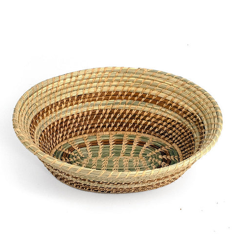 Oval pine needle basket with green wild grass