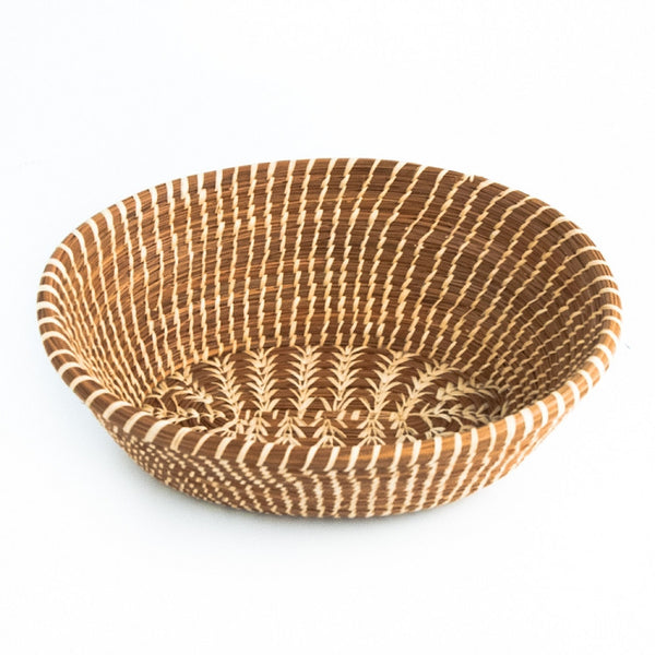 Oval pine needle basket with raffia