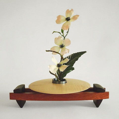 Framed disc ikebana vase