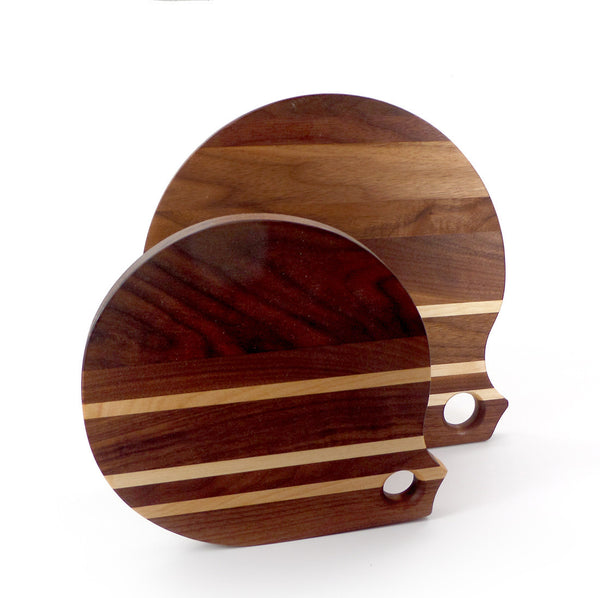 Round walnut cutting boards with birch stripes