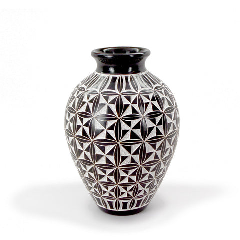 Ceramic vessel with hand-cut black-and-white design