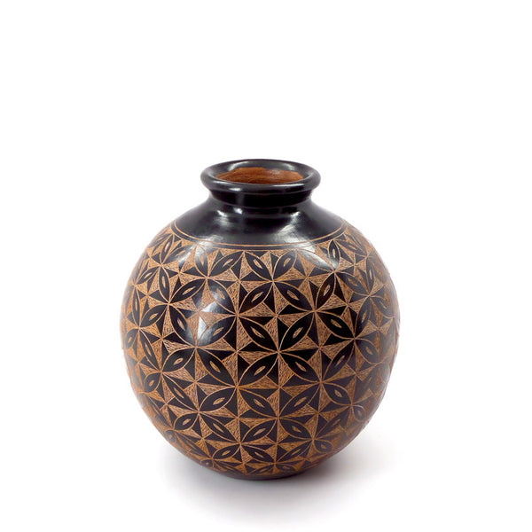 Ceramic vessel with hand-cut single-color design