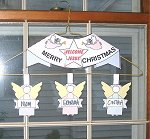 family christmas greeting-angels on window