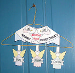 family christmas greeting-angels on door