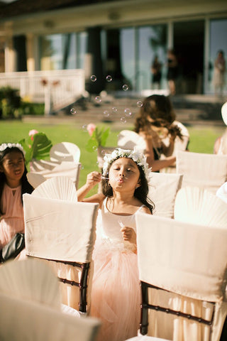 Flower Girl Blowing Bubbles Wedding Ceremony