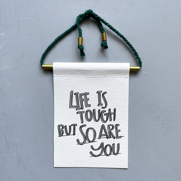 Life Is Tough But So Are You Brass and String Hanging Banner