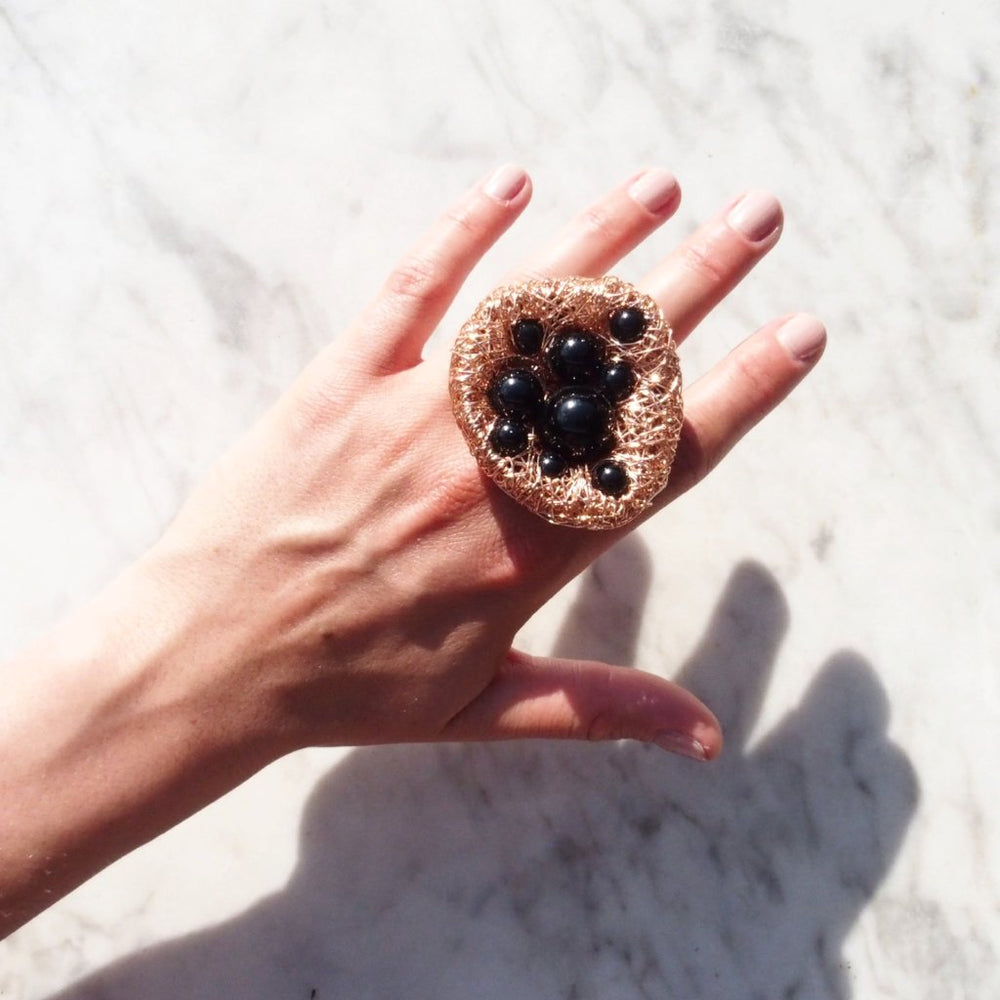 Rose gold ring with Polished Onyx for the Bubbles series of the Art Scenes Collection by Sheila Westera
