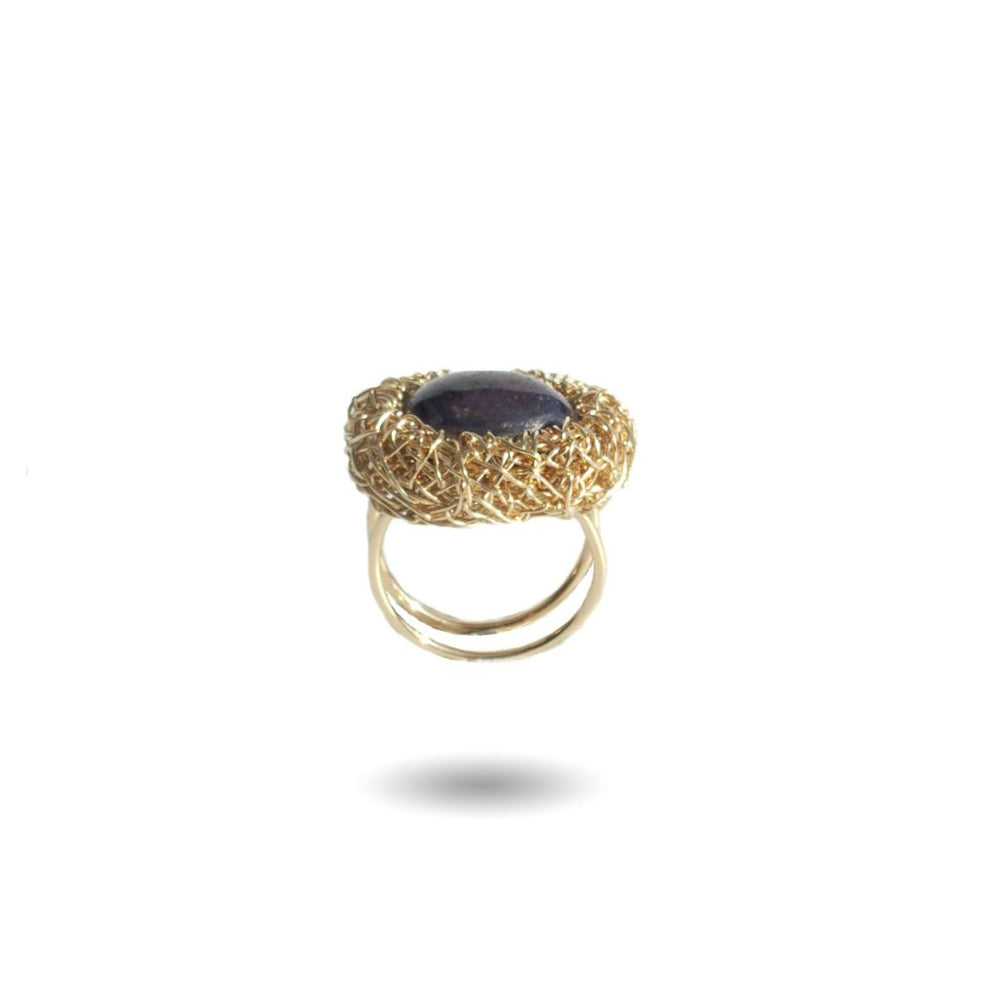 Yellow gold ring with a Korund stone, from Conversation piece collection by Sheila Westera