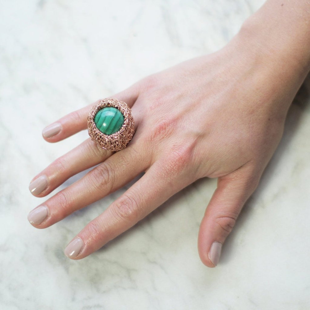 Yellow gold ring with a round Malachite stone, from Conversation piece collection by Sheila Westera