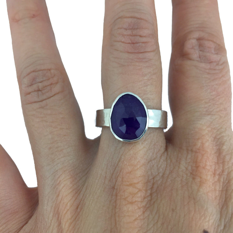 rose cut amethyst ring on finger