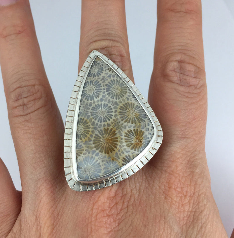 statement fossil coral ring on hand