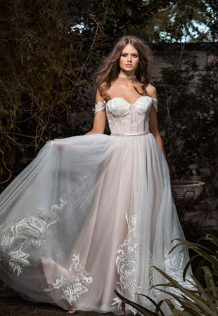 Blush wedding dress with side sleeves